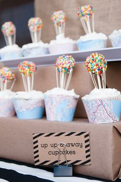 Up, Up, and Away Cupcakes: How incredible are these balloon cake pop-topped cupcakes? We especially love the idea of using maps as cupcake wrappers.  Source: LH Photography