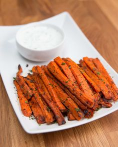 INGREDIENTS2 carrots2 tablespoons olive oil1 tablespoon fresh parsley, chopped1 teaspoon paprika1 teaspoon salt1 teaspoon pepperPREPARATION1. Preheat oven to 425°F/220°C.2. Cut carrots into fries and combine in a large bowl with olive oil, parsley, paprika, salt, and pepper.3. Place on baking sheet lined with parchment paper in a single layer. Bake for 20-25 minutes, flipping halfway. 4. Enjoy with dip in recipe above!