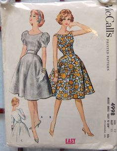 """end of 50d. McCall's 4998: """"Scoop neck dress with fitted bodice and flared six-gore skirt. Dress may be sleeveless, have 3/4 length set in sleeves or short puff sleeves, stiffened at top with crinoline or taffeta. Left side zipper placket. Interfaced contour belt is buttoned at center back. c. 1959"""""""