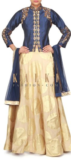 Beige brocade lehenga with sequin embellished blouse only on Kalki