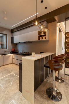 A very sleek and simple Apartment design can be seen in the similar colour combinations used in the house.The apartment design with its mid-century modern design is a great specimen of the classy interiors that are idolized today. Kitchen Bar Design, Home Decor Kitchen, Interior Design Kitchen, Kitchen Furniture, Kitchen Modular, Modern Kitchen Interiors, Apartment Design, Lodge Decor, Dining