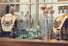 Use glass bottles to display necklaces and bracelets.