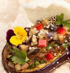 A fantastic #vegetarian side dish, Alfred Prasad's spiced aubergine recipe is packed with flavour. The chef serves his smoked aubergine inside a roasted aubergine skin, but you could equally serve it in a bowl as a punchy dip.