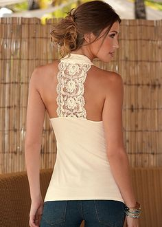 Make them look back in the Venus lace back surplice top.