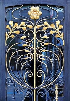 Beautiful blue & gold floral design. Art Nouveau Wrought Iron Door in Barcelona, Spain