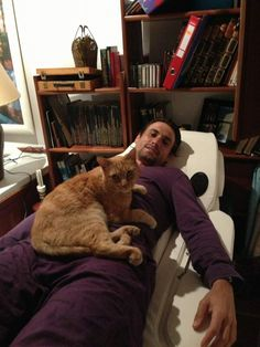 David Ferrer Spanish Tennis Player, at home with one of his cats, Feb. 2013