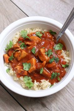 Slow Cooker Chicken Tikka Masala Recipe--tender bites of chicken in a tomato sauce with creamy coconut milk. We like to serve this with rice or naan bread. The sauce is so good I could drink it.