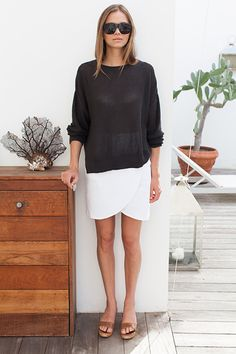 White skirt, semi transparente black sweater... perfect summer outfit