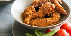 Cumin Chicken Wings.  ½ C butter 4 cloves garlic 2 tsp cumin ½ C tomato sauce 1 T Worcestershire ½ tsp salt ½ tsp pepper 2 lb wings 1 C flour oil for frying Melt butter, stir in garlic. Cook 2 min. Add cumin, tomato sauce, Worcestershire , S&P. Simmer 5 min.  Season wings with S&P. Dredge in flour. Heat oil to 375°. Fry wings 10 min. Place on paper towels to drain. Toss the wings in the cumin sauce and garnish with cumin seeds.