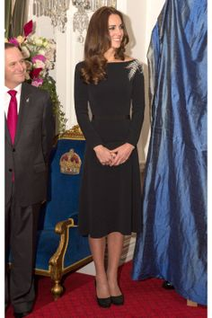For a reception at the Government House, Kate chose an elegant black dress by one of her favorite designers, Jenny Packham. A silver fern on the dress's left shoulder paid homage to one of New Zealand's most recognizable emblem