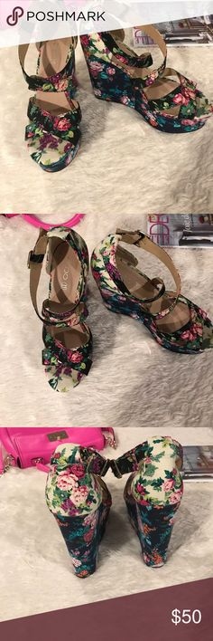 Aldo Floral Wedges Beautiful Aldo Floral Wedges. Worn only once in great condition. Heel measures approx 5.5 inches Aldo Shoes Wedges