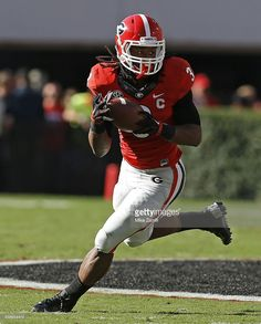 Running back Todd Gurley of the Georgia Bulldogs rushes with the ball against the Vanderbilt Commodores at Sanford Stadium on October 2014 in Athens, Georgia. Sanford Stadium, Vanderbilt Commodores, Todd Gurley, Georgia Girls, Running Back, Sports Stars, Georgia Bulldogs, Lsu, Big Dogs