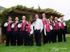 Pink and Black Wedding Ideas | Groomsmen with pink vests and ties""