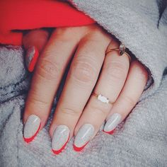 instagram @Christina Rinaldi | Heather grey #nails with asymmetrical neon coral tips.