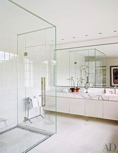 Former Sony Music head Tommy Mottola single-mindedly pursued a remarkable vision when building the Connecticut house he shares with his superstar wife, Thalia Luxury Bathroom, Architectural Digest, Calacatta Marble Floor, Bathroom Decor, Home, Thassos Marble Bathroom, White Cabinetry, Bathroom Design, Steam Room Shower