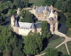 Château d'Ainay-le-Vieil, Jacques Coeur  bought it in 1435 and Charles de Bigny (ancestor of the current owners) in 1467.  In the large living room, one of the most beautiful fireplaces of the Loire Valley, is a testament of the visit of King Louis XII and Queen Anne of Brittany.  Souvenirs of le Grand Colbert, minister of Louis XIV are also presented.  In the park is a magnificent rose garden. Some varieties of roses here date back to the 15th c.