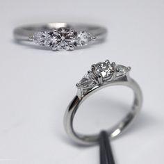 Brilliant cut and pear cut diamond ring.