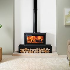 The Stovax Riva Studio 1 wood burning stove is a high performing wood burning stove only stove which has a compact, yet innovative design. With a heat output the Riva Studio 1 wood burning stove will provide ambiance and warmth. Wood, Living Room With Fireplace, Wood Fireplace, Wood Burning Stoves Living Room, Standing Fireplace, Contemporary Fireplace, Free Standing Wood Stove, Freestanding Fireplace, Modern Fireplace