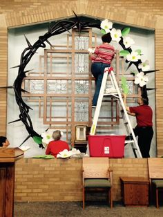 Easter church decor: In the process of transformation...attaching giant Dogwood blossoms made by our decorating team.  We focused on the Legend  of the Dogwood for Easter this year.