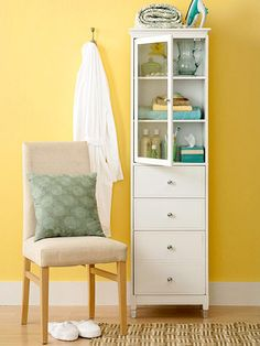 Guest bedroom storage cabinet.  Include overnight essentials.  Stack colorful towels and soaps on the shelves. Keep an iron close at hand by storing it on top of the armoire. Leave the bottom drawers empty so guests can stash their own items.
