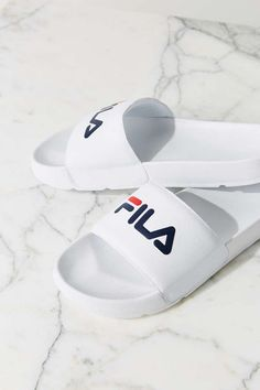 Fit girls will flock to these Fila pool slides that deserve major street cred.