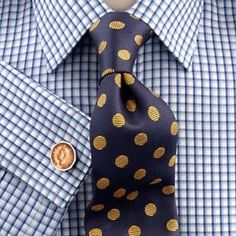 Window pane check with a spotted tie. The spots match the cufflinks, and the navy compliments the blues in the check.