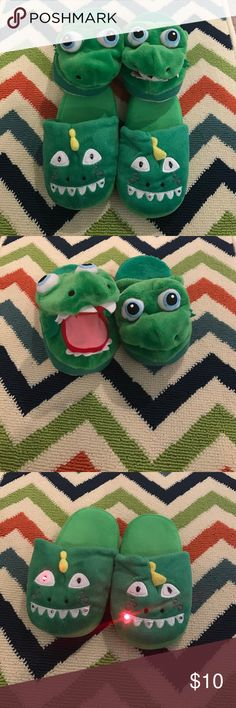 """TWO pair of slippers deal Boys age 3-5💙 TWO pair of slippers deal Boys age 3-5💙. Pair in second pic are """"Stompeez"""" as seen on tv. Mouth opens and closes while walking. Second pair lights up. These would best fit ages 3-5. Shoe size 10-12  Some wear on bottom of both pair. Other than that, supper clean and in great condition. Clean, smoke free home. Not Old Navy. Posted here for advertising only. Old Navy Shoes Slippers"""