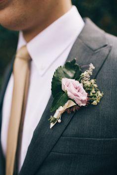 pink boutonniere - photo by Jessica Janae Photography http://ruffledblog.com/romantic-forest-wedding