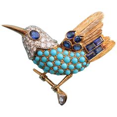 CARTIER Paris - An 18-carat Gold Bird Brooch set with cabochon-cut Turquoises and brilliant-cut Diamonds (app. 2 carats) set in Platinum; the eye and feathers are set with oval- and baguette- cut Sapphires (app. 2 carats). The bird is perched on a tiny branch with a trapeze-cut Diamond, signed and numbered: Cartier, Paris, 012386, - circa 1965 - weight: 19 grams, dimensions: 4.8 x 5.3 cm. •$57,692.00