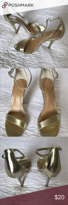 Chinese Laundry Gold Ankle Strap Stiletto Like new Chinese Laundry Gold ankle strap stilettos size 7.5. On trend and perfect for weddings, prom, formats, etc. Heel height approximately 4 inches. Wear on bottom shown appears to be from trying on the shoe (I purchased from another posher who listed as new). The footbed and upper of the heel show no signs of wear. Chinese Laundry Shoes Heels