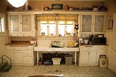 Sookie Stackhouse's kitchen on True Blood. It looks a mess here, but I keep noticing the shelf on top of her cabinets. So cute!