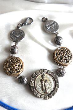 Vintage assemblage bracelet vintage medal by frenchfeatherdesigns