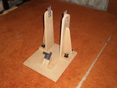 Bicycle Wheel Truing Stand by kknh3 -- Homemade bicycle wheel truing stand constructed from MDF, locking knobs, and aluminum plate. http://www.homemadetools.net/homemade-bicycle-wheel-truing-stand-5