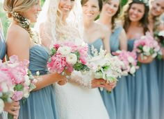 Powder blue bridesmaids carrying pretty pink and white bouquet | photography by http://www.buffydekmar.com/