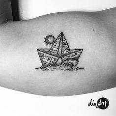 Newspaper paper boat sea ocean sun tattoo