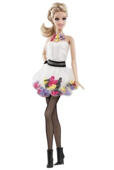 """Shoe Obsession™ Barbie® Doll, Barbie® put the """"s"""" in stilettos, slingbacks and style and has fun with fashion from head to toe! She wears a white tulle bubble dress that features yellow, purple, black and pink (of course!) shoes sewn right into her skirt! Unique stiletto necklace and iconic Barbie ponytail complete her playful look. Wouldn't you love to be in her shoes?"""