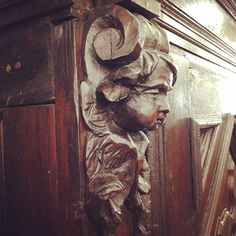 A gorgeous carving on a cabinet @wertzbrothers #carving #wood #vintage #furniture #cupid