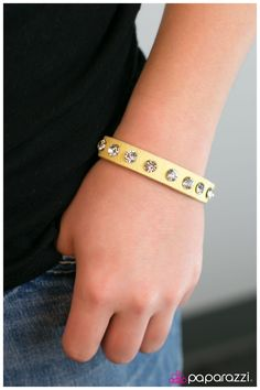 An Affair to Remember - Yellow  A strip of yellow leather is emblazoned with a row of blinding rhinestones. Features an adjustable clasp closure.  Sold as one individual bracelet.