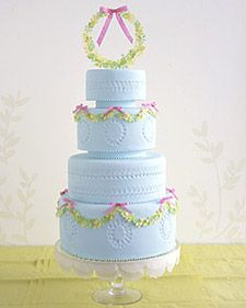 ~A pale-blue wedding cake draped in garlands of tiny leaves and delicate paper bows. With matching wreath topper, the cake sits on a pedestal stand decorated with layers of scalloped tissue. Purple Wedding Cakes, Amazing Wedding Cakes, Amazing Cakes, Blue Wedding, Spring Wedding, Wedding Flowers, Fondant Cakes, Cupcake Cakes, Cupcakes