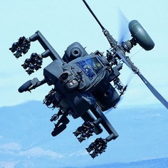 A Boeing AH-64 Apache Longbow outfitted for some tank-busting with 16 Hellfire anti-tank missiles under wing.