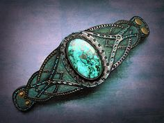 Sacred woods is a tooled leather antique looking cuff bracelet with huge bluish-green malachite-chrysocolla cabochon. This exclusive cuff fits up to 6 3/4 (~17cm) wrist and is 2 7/8 (7.3cm) wide. This particular bracelet was MADE TO ORDER! If youd like me to make something special for