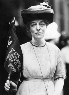 """A suffragette stands with a """"Votes For Women"""" banner in 1910.#feminism #gender"""