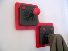 game on! Old video game joysticks,  would make great coat hanging area!
