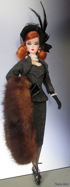 Flickr Silkstone Barbie, A Red haired shoulder length hair Barbie with Grey tweed suit, Black hat with feathers, black heels, black gloves and pearl jewelry.
