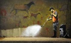 Brilliant BANKSY art commenting on the overlap between cave paintings and graffiti.