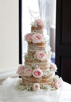 Naked cake with sweet avalanche roses and baby's breath www.littleblackcat.co.uk