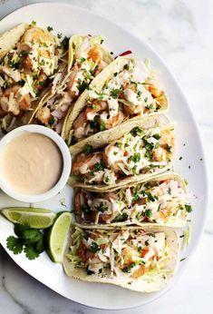 Easy, healthy and, most importantly FABULOUS Shrimp Tacos! With cabbage and radish slaw for crunch and creamy, spicy Shrimp Taco Sauce! Easy and Delicious Shrimp Tacos - Pinch and Swirl her Spicy Shrimp Tacos, Shrimp Taco Recipes, Fish Recipes, Mexican Food Recipes, Dinner Recipes, Crispy Tacos, Chicken Tacos, Entree Recipes, Fish Tacos