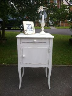 Handpainted and distressed small side table by The Whitewashed Barn.    Please find us at www.facebook.com/thewhitewashedbarnhandpaintedfurniture
