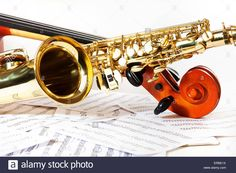 Cello tuning pegs and shiny golden alto saxophone Stock Photo, Royalty Free Image: 83231062 - Alamy