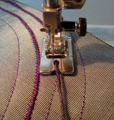 Couching is simply sewing a heavy thread in place with a finer thread. Its a retro technique, too, that was originally done by hand, but it works beautifully by machine as well. I use a zigzag stitch to secure the heavy thread in place. And, if you have a cording foot— the foot guides the thread as you sew.: